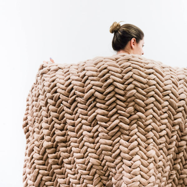 woman holding blanket made from Mama Knows Luxury La Reserve Design Extreme Knit Extra Large Blanket Kit