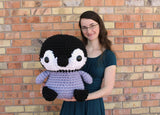 Woman holding penguin made from Mama Knows Luxury Giant Penguin Amigurumi Yarn and Pattern Crochet Kit