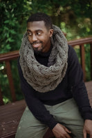 Man wearing cowl made from Mama Knows Luxury Cable Mountains Cowl Knitting Kit