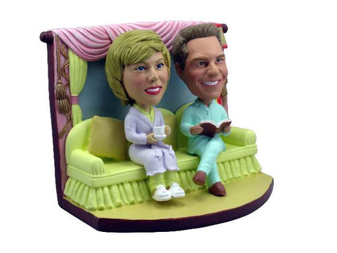 Bobblehead Couple on Couch in Pajamas