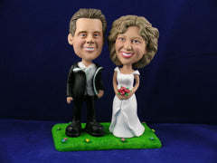Married Couple Standing on Grass Cake Topper Bobbleheads
