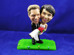 Groom Carrying Bride on Grass Cake Topper