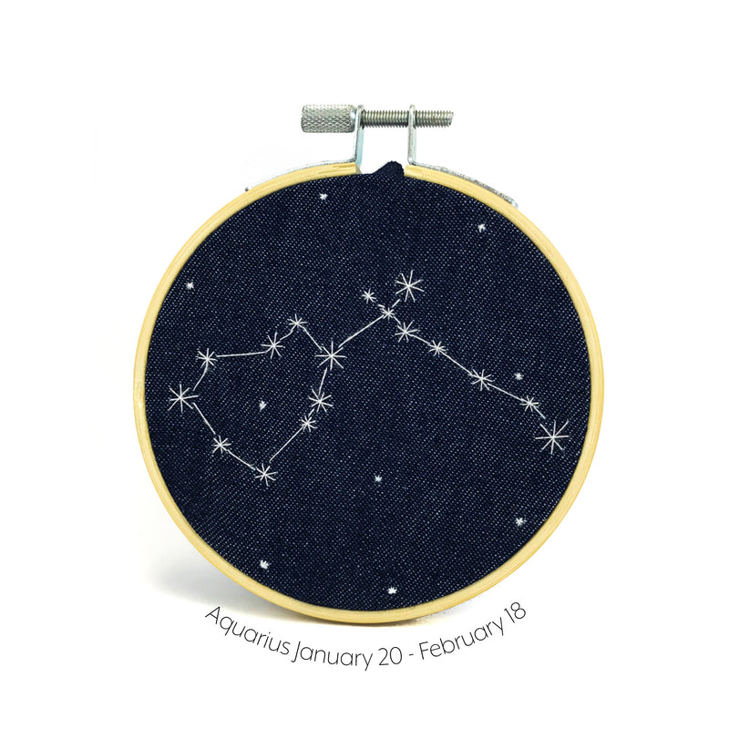 Aquarius Zodiac stitched hoop by Chelsey Greene