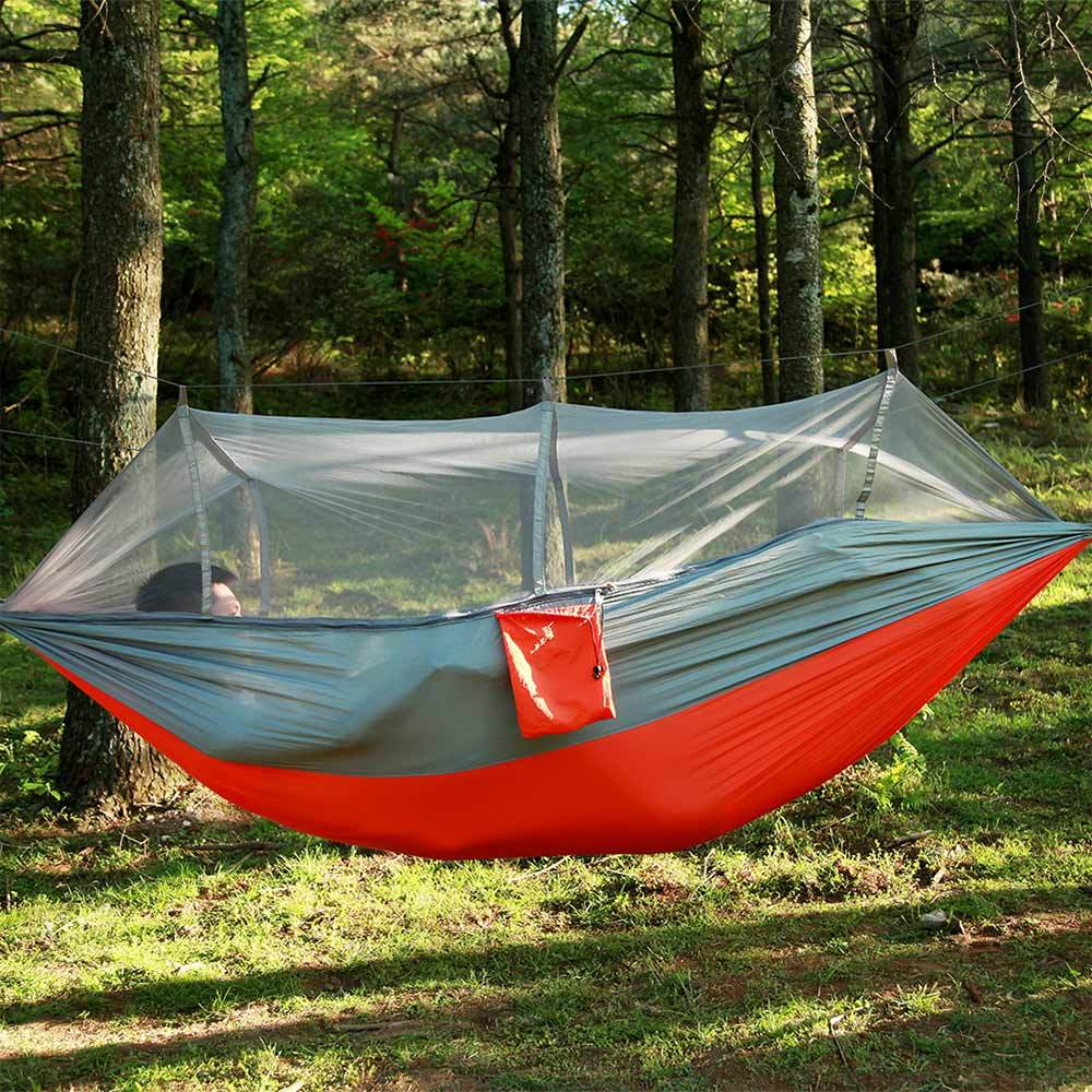 person hanging hammock tank shark or winter camping s tent double