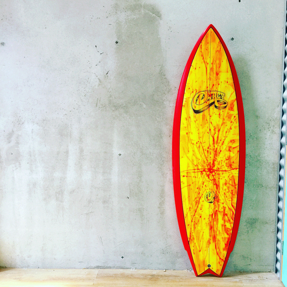 image of the disco twin surfboard with yellow and red surfboard art