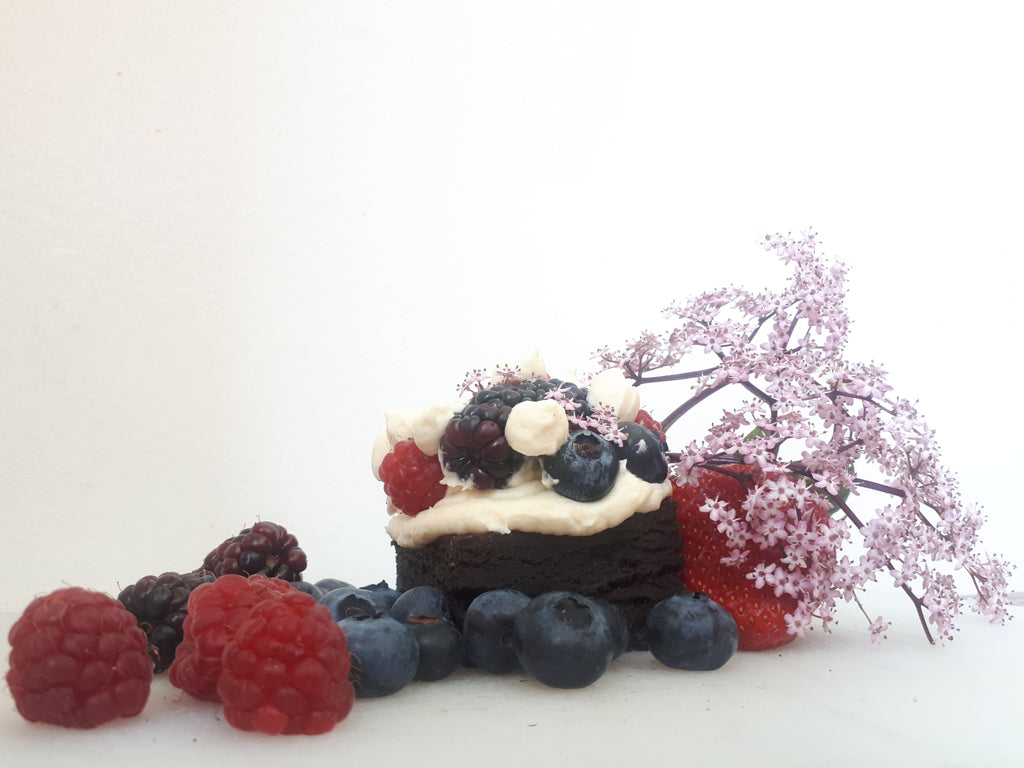 Brownie with brandy mascarpone cream and fresh berries