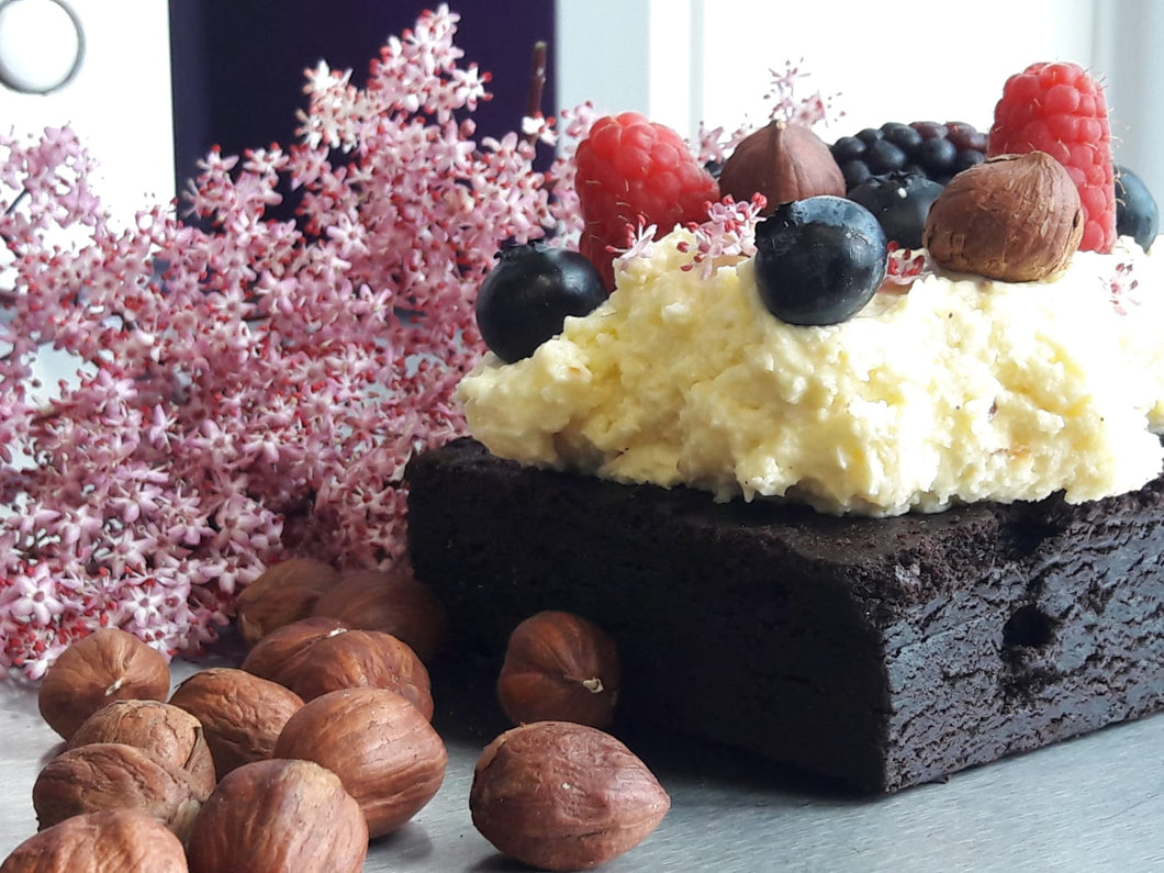 Filled Brownie with brandy mascarpone cream and fresh berries