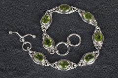 Charming Sterling Silver Faceted Peridot Bracelet