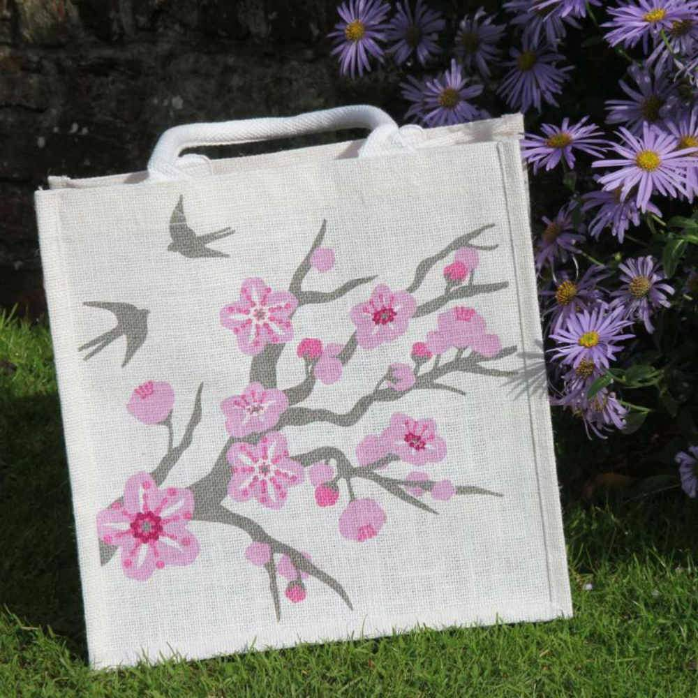 Square Jute Shopping Bag by Shared Earth - Cherry Tree with Swallows &Keep