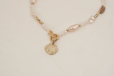 Shell charm with toggle bar
