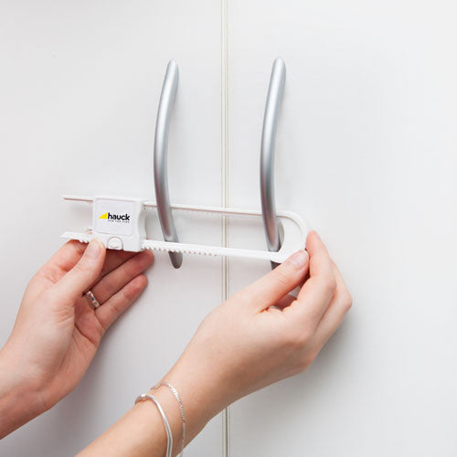 Secure cupboard and kitchen door handles with Close Me 1 to protect children's delicate, little hands