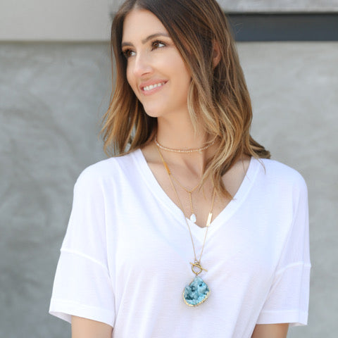 white t shirt with statement jewelry