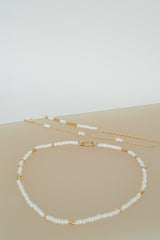 Triple white beads bracelet gold plated