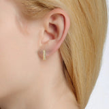 Diamond bar earring on ear