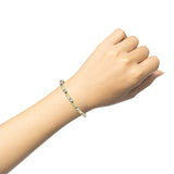 14k  yellow and white gold diamond tennis bracelet on wrist