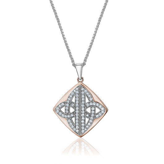 A 14k rose and white gold diamond pendant