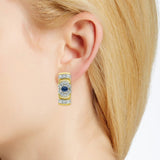 Diamond and sapphire earrings in 18 k gold on ear