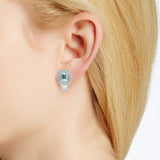 Diamond and aquamarine earrings in 18k white gold on ear