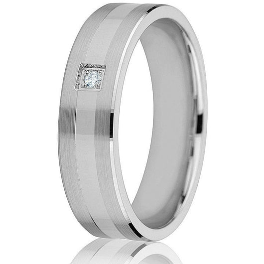 Two satin strip edges with a high polish centre offsets the one diamond in white gold in this 6 m.m. wedding band.
