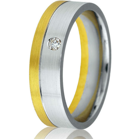 Modern solid two-tone 6 m.m. comfort-fit wedding band in 14k white and yellow gold with one round natural brilliant diamond .05 ct.