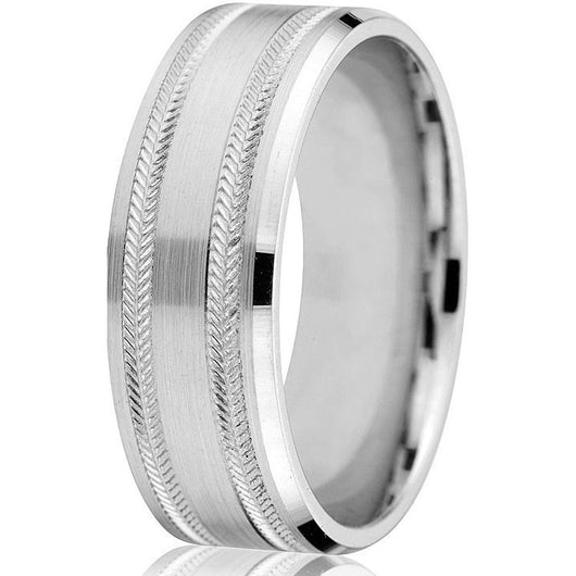 Classic flat engraved 8 m.m. band with herringbone engraving on a bright white gold base.