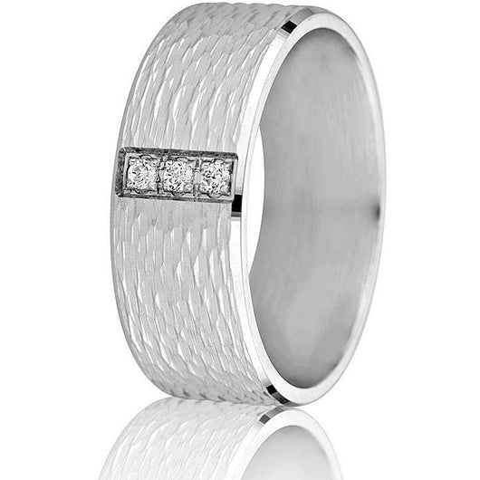 Wide 8 mm comfort-fit wedding band with textured engraving and shiny bevelled edges set with 3 round brilliant cut diamonds in white gold.
