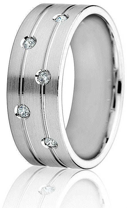 Contemporary look in this  8 mm wedding band with 2 bright engraved parallel lines and satin finish top with 5 round natural brilliants( 0.10 cts) in 10k white gold.
