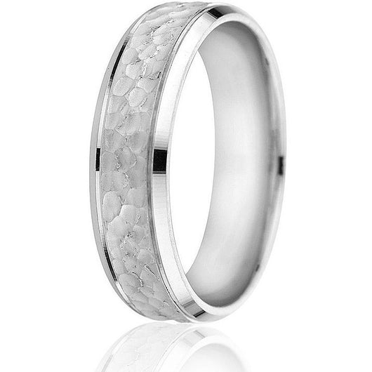 Bright cut edge followed by an engraved line and hammered centre gives this classic style wedding band an updated twist in 14k white gold.
