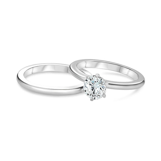 The PNJ classic platinum solitaire diamond ring with a 0.75 carat round natural brilliant in .950 platinum with a rounded shank featuring flat sides