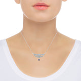 Diamond and sapphire pendant necklace on neck