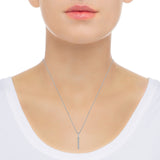 Vertical diamond bar necklace in 14k white gold on neck