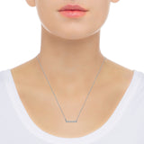 Diamond bar necklace in 14k white gold on neck