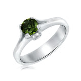 Peridot and diamond ring in 18kt white gold