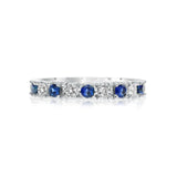 Classic four prong diamond and sapphire wedding band