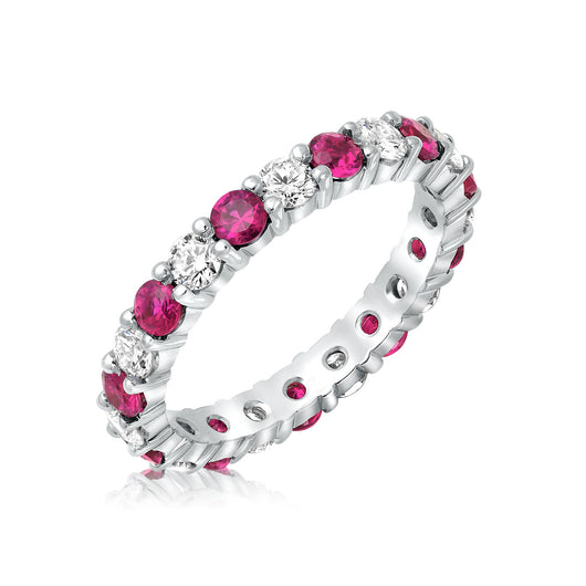 Shared prong diamond and pink sapphire wedding band in 14 karat