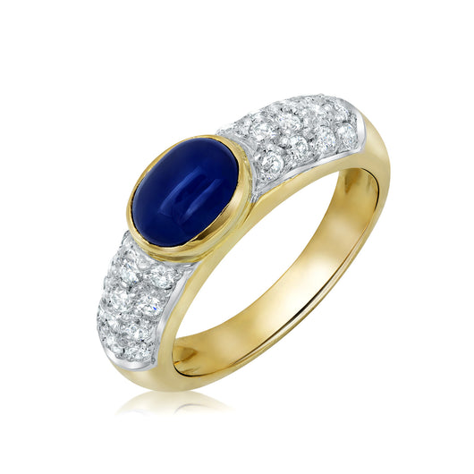 Bezel set oval cabochon sapphire and diamond ring in 18k gold