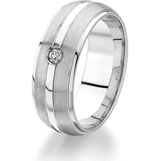 Classic domed 8 mm wedding band with a bright cut edge, two-strip satin finish and shiny centre strip with one round natural brilliant for maximum contrast and effect in 14 k white gold.