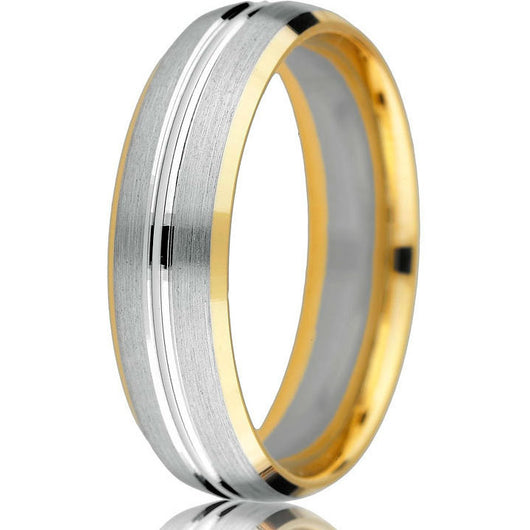 Modern update of a classic domed wedding band in white and yellow gold with bevelled edge and a 14k white gold inlay with an engraved groove in centre.
