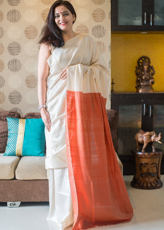 IHAAT.IN Handwoven TUSSAR Off White colour with Peaches Orange Pallu