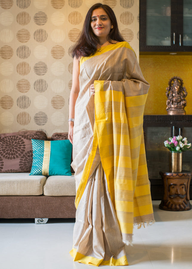 ihaat.in Handwoven TUSSAR SILK NATURAL COLOUR WITH YELLOW BORDER AND YELLOW STRIPE PALLU