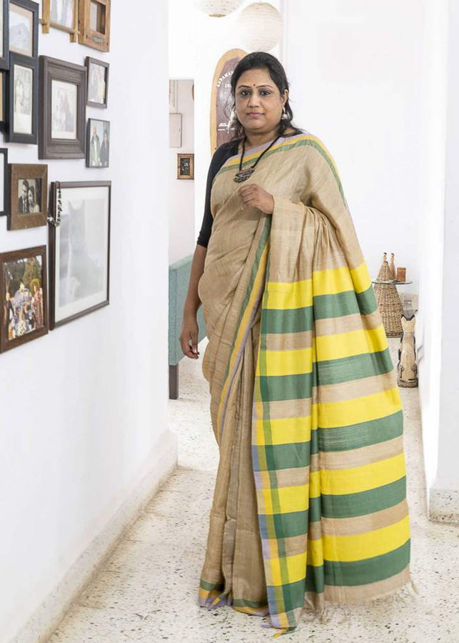 ihaat.in Handwoven TUSSAR SILK NATURAL COLOUR WITH YELLOW GREEN BLUE BORDER AND YELLOW GREEN BLUE STRIPED PALLU