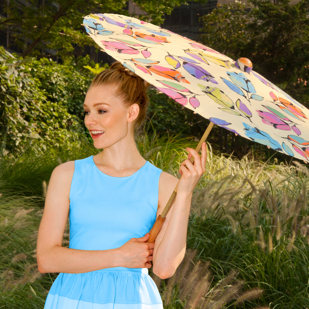 Woman carrying Lily-Lark bellflower print handcrafted bamboo and fabric UV sun parasol / umbrella