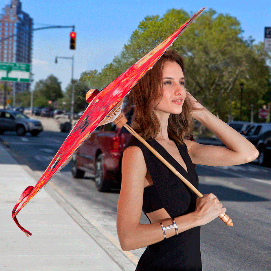 Woman carrying Lily-Lark coral and red rose print handcrafted bamboo and fabric UV sun parasol / umbrella