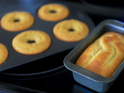 Donuts in pan with a cake loaf