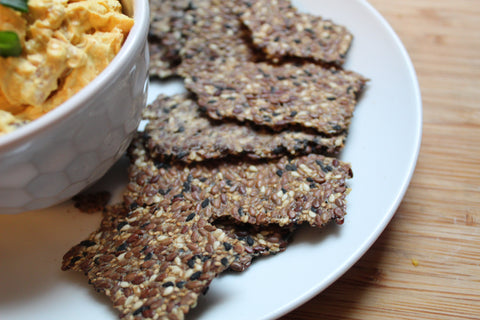 low carb black sesame crackers with bacon and egg tadka dip recipe  on switchgrocery