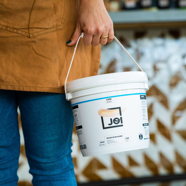 JOI Almond Nut Milk Base 8lb pail in use on SwitchGrocery