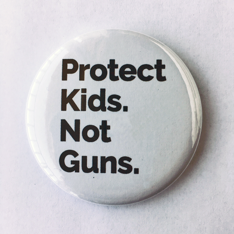 "Button: ""Protect Kids. Not Guns."""