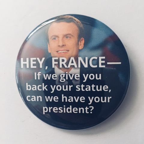 "Button: ""If We Give You Back Your Statue, Can We Have Your President?:"" French President Emmanuel Macron"