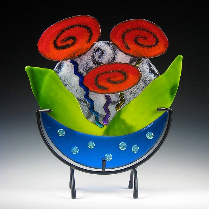 Blue Rose Bowl with Red/Orange Roses in stand by Charlotte Behrens