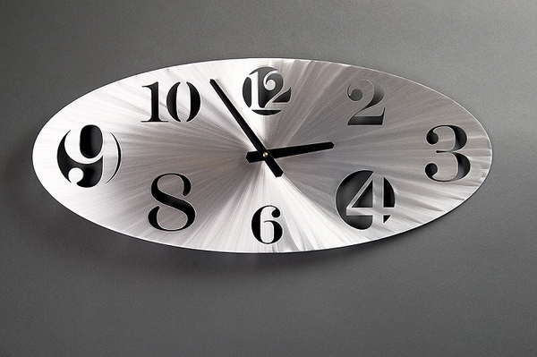 Horizontal Oval Clock by Sondra Gerber